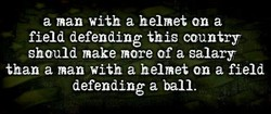 a man with a helmet on a 